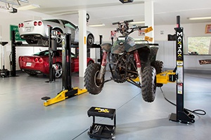 MaxJax portable car lift under car access